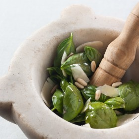 Making pesto with a mortar and pestle